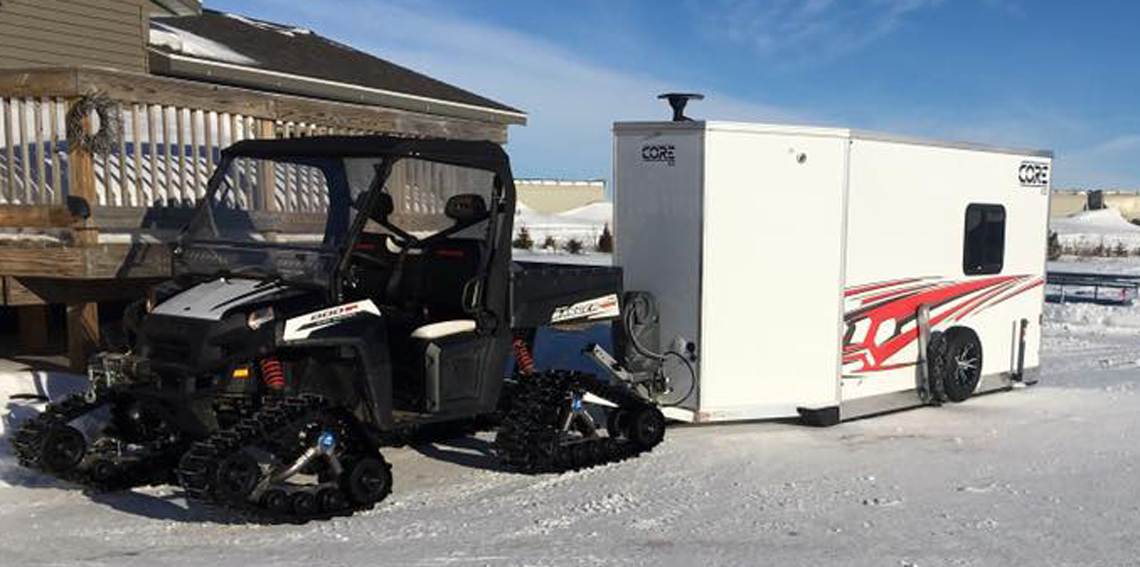 ATV with a fish house trailer